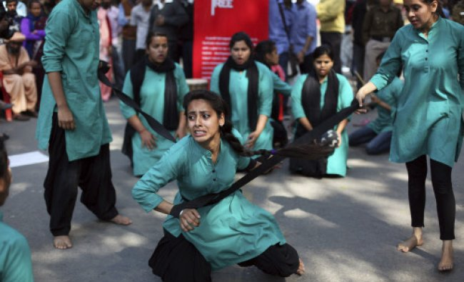 A group of college girls perform a street play on violence against women, to mark International ...