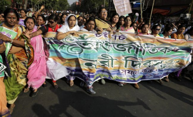 Supporters of Trinamool Congress party participate in a rally to mark International Women\'s Day ...