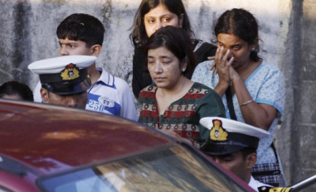 Wailing relatives of Commander Kunal Wadhwa after he was cremated in Mumbai on Saturday.