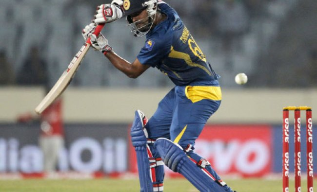 Sri Lanka\'s Lahiru Thirimanne plays a shot against Pakistan during their 2014 Asia Cup final ...