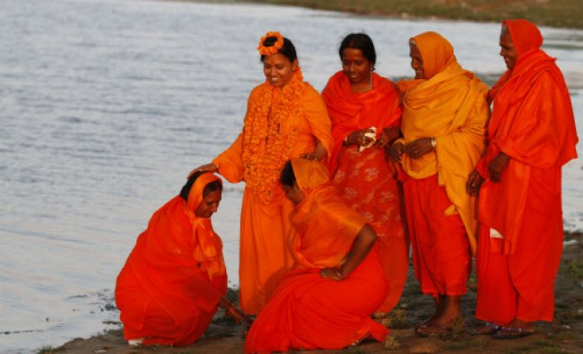 Mahant Trikaal Bhawanta, leader of the first group of women sadhvi, blesses devotees ...