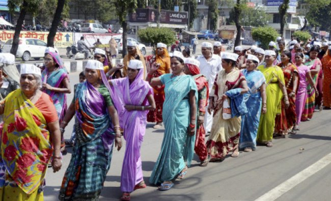 Women taking out rally under the banner of Aam Aadmi Party, demanding dignity, safety and freedom...