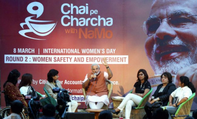 BJP prime ministerial candidate Narendra Modi interacts with women from various parts of the ...