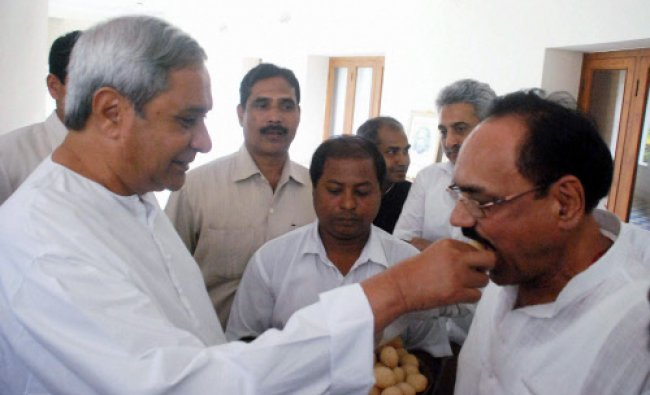 :Odisha Chief minister and BJD chief Naveen Patnaik giving sweet to Congress leader and leader ...