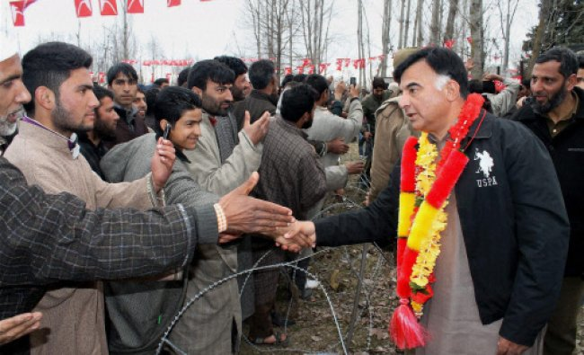 Jammu and Kashmir National Conference (NC) leader Mehboob Beigh shake hands with party....