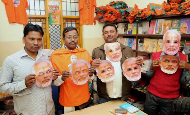 BJP workers showing election materials for upcoming Lok Sabha polls at BJP headquarters ...