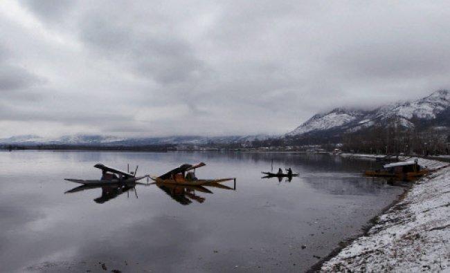 Boatmen on their Shikaras after a snowfall, at Dal Lake in Srinagar on Monday. PTI Photo