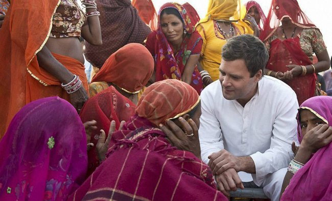 Congress Vice President Rahul Gandhi interacts with a group of women mine workers at Kolayat ...