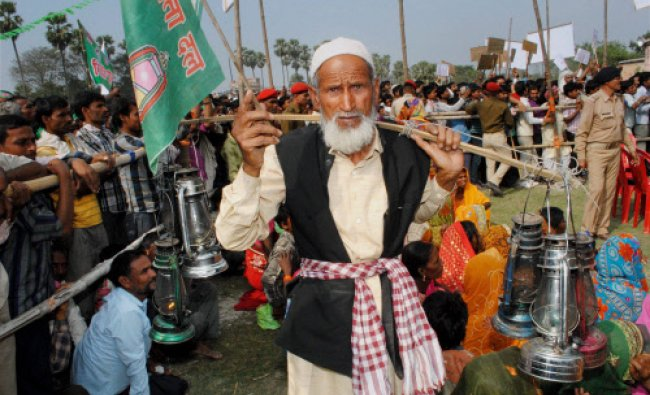 A RJD supporter at party supremo Lalu Prasad\'s election campaign rally in East Champaran on Monday.