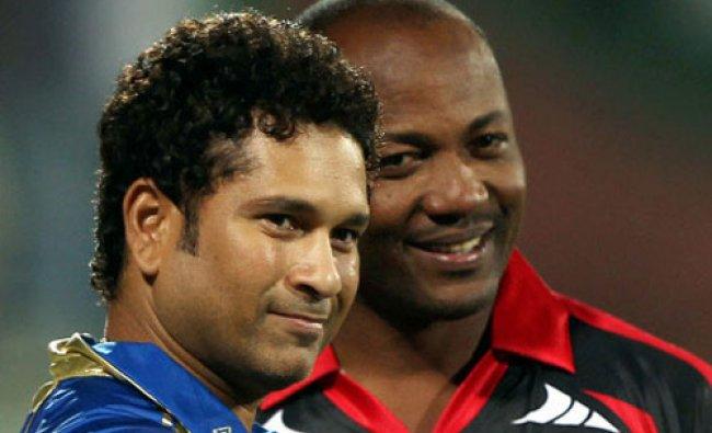 Cricket legends Sachin Tendulkar and Brian Lara pose for photographers during the Champions...