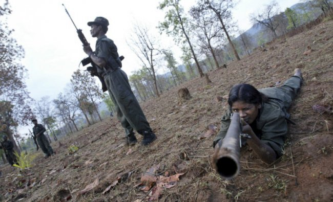 Maoist rebels exercise at a temporary base in the Abujh Marh forests, in the central Indian state...