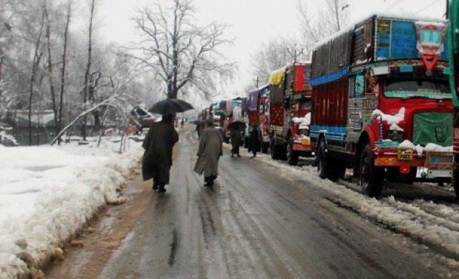 Vehicles stranded at Qazigund as Srinagar-Jammu National Highway was closed due to...