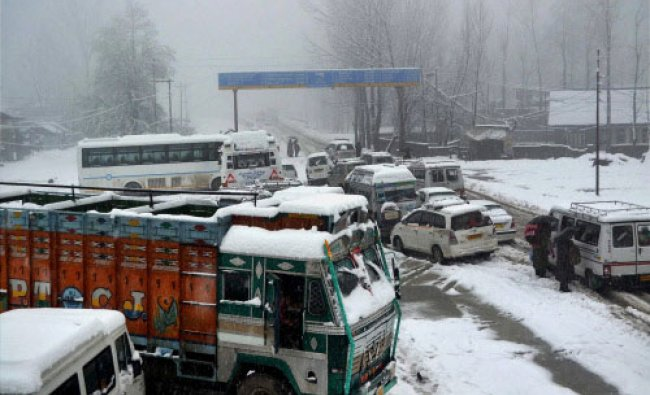 Stranded vehicles due to heavy snowfall in Qazigund, Anantnag on Tuesday. PTI Photo