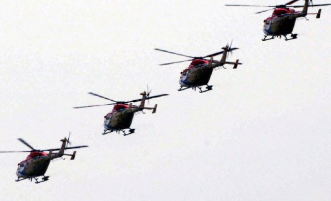 Sarang helicopter display team of the Indian Air Force performs during the presentation ...