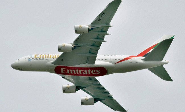 Airbus A380 of Emirates arrives on the inaugural day of the 4th India Aviation 2014 ...