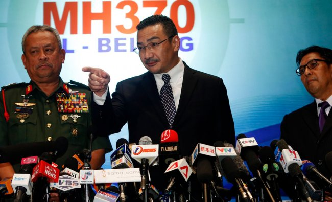 Malaysia\'s acting Transport Minister Tun Hussein answers questions on missing Malaysia Airlines MH37