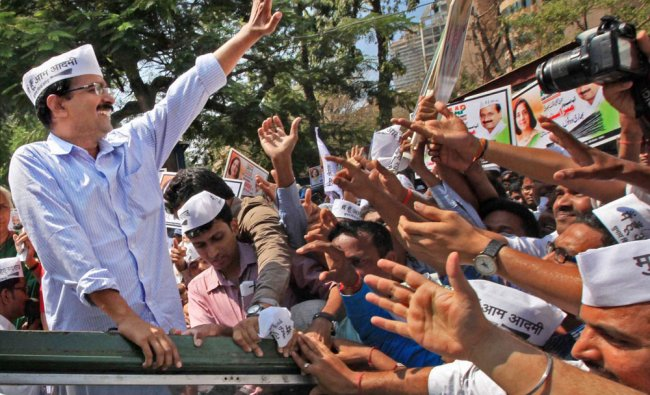 AAP chief Arvind Kejriwal waves during a road show in Mumbai ...