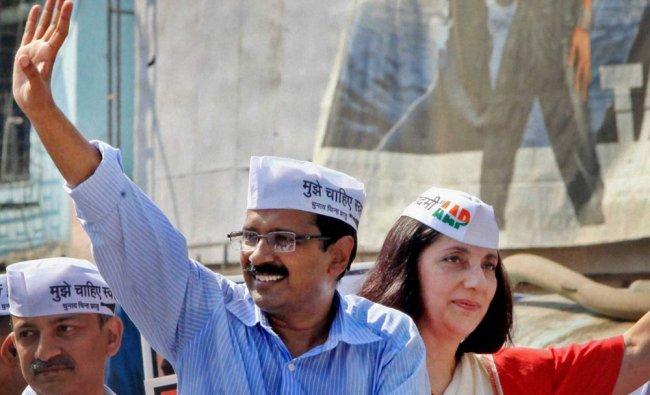 Arvind Kejriwal waves along with party\'s South Mumbai candidate Meera Sanyal in Mumbai ...