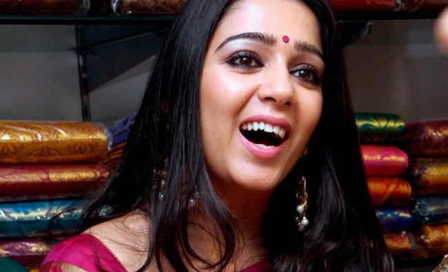 Telugu Actress Charmi Kaur during the inauguration of a shopping mall in Hyderabad ...