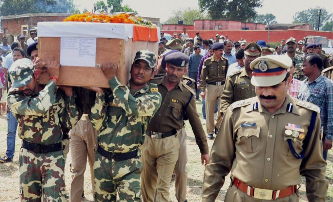Security personnel carry the coffin of CRPF HC Pradeep Kumar, who was killed by Maoists ...