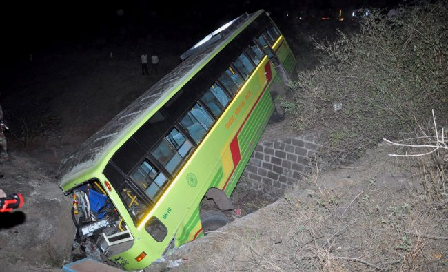 A bus which fell off the road after a collision with a car at Sangamner in Maharashtra ...