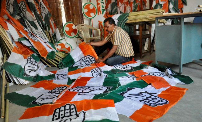 A Congress worker arranging party flags in Agartala on Thursday...