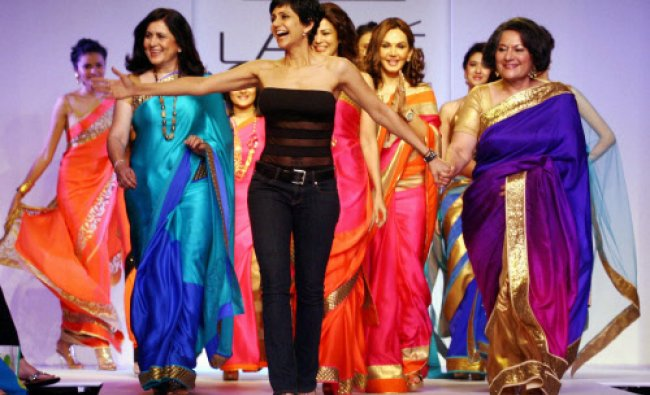 Anchor-actress-designer Mandira Bedi flanked by her mother Geta Bedi (R) walks the ramp during her f