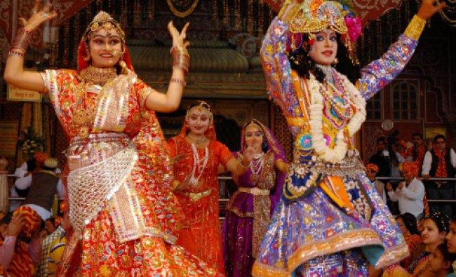 Artists dressed up as Lord Krishna and Radha celebrating Holi at Govind Devji Temple in Jaipur ...