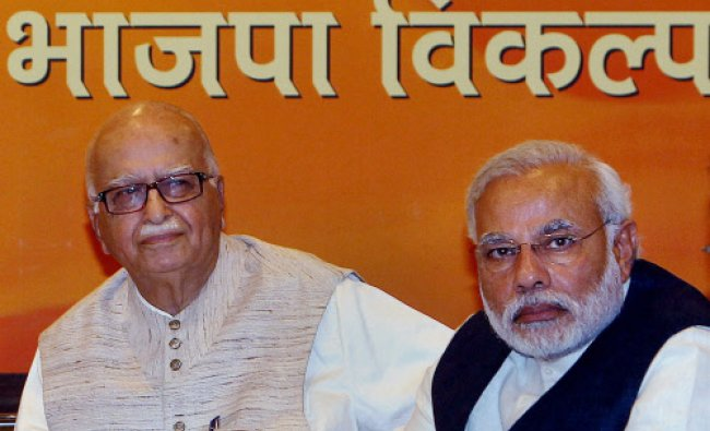 BJP Patriach LK Advani and party\'s PM candidate Narendra Modi during party\'s Central Election ...