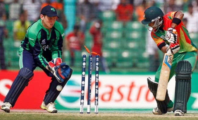 Bangladeshs Sabbir Rahman is bowled out by Irelands Andy McBrine during a warm up cricket match...