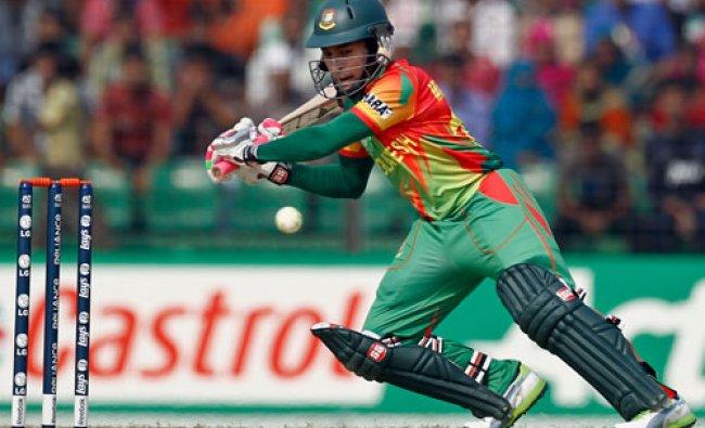 Bangladeshs Mushfiqur Rahim plays a shot against Ireland during a warm up cricket match ahead of...
