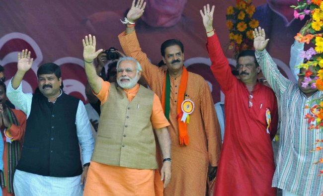 Narendra Modi with Odisha state unit president, K V Singhdeo during an election rally in Odisha ...