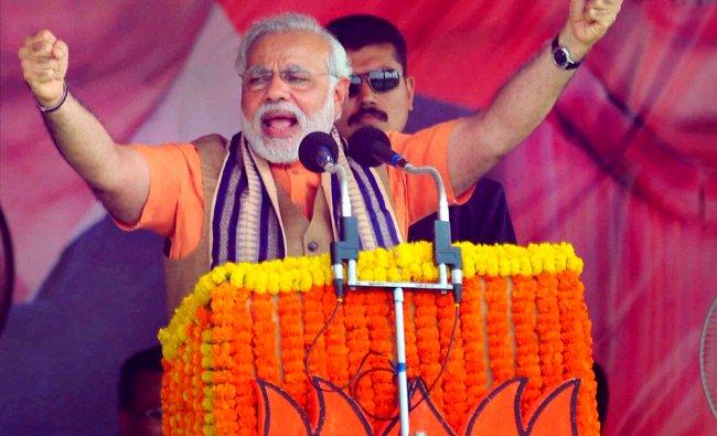 BJP\'s PM candidate Narendra Modi addressing an election rally in Sambalpur, Odisha ...