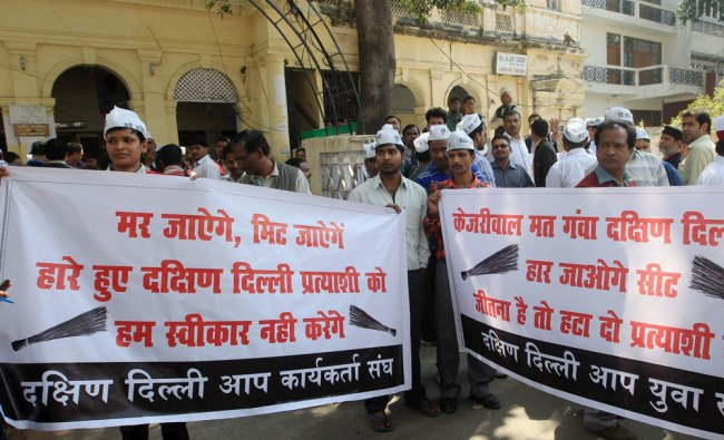 AAP volunteers from South Delhi protest over ticket distribution issue at the party office ...