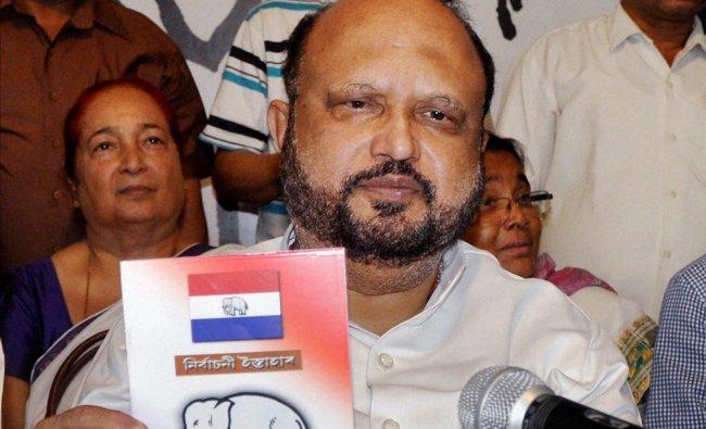 Asom Gana Parishad President Prafulla Kumar Mahanta releasing the party\'s election manifesto ...
