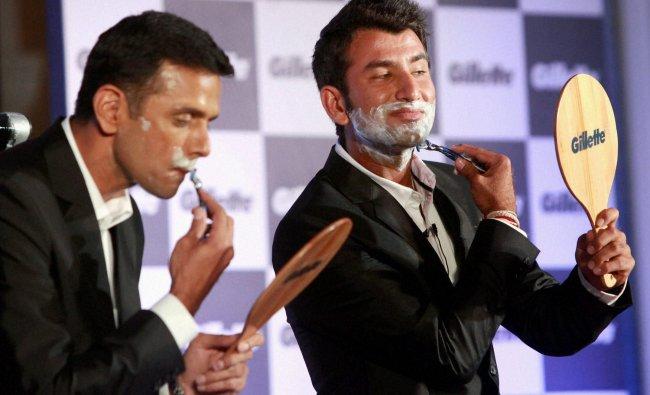 Former Indian Cricketers Rahul Dravid and Cheteshwar Pujara shaving during the launch ...