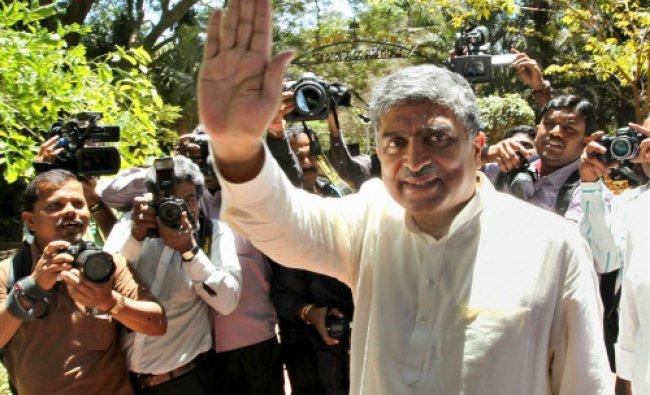 Congress Candidate from Bangalore South, Nandan Nilekani waves at media in Bengaluru on Friday