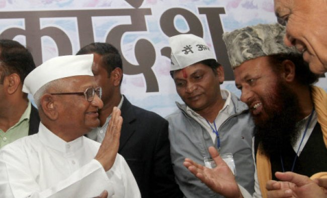 Social activist Anna Hazare meeting supporters after a function in New Delhi on Friday. PTI Photo