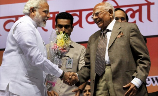 Gujarat Chief Minister and BJP\'s PM candidate Narendra Modi with Ram Jethamlani at a meeting ...