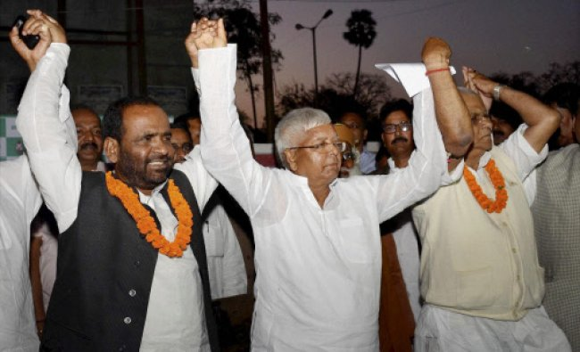 RJD chief Lalu Prasad welcomes BJP and JD(U) leaders who joined the party in Patna on Friday.