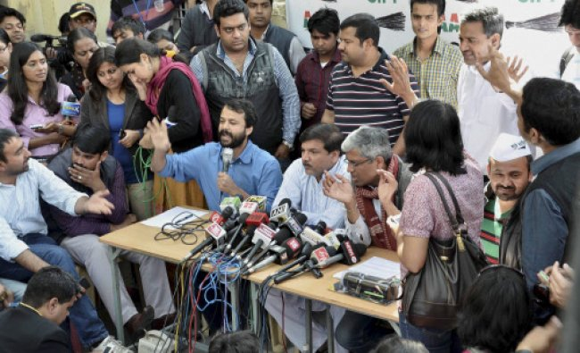 AAP leaders Ashish Khetan (L) Sanjay Singh and Ashutosh speaking to media in New Delhi on Friday.
