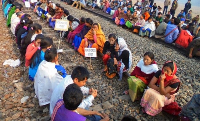 Members of All Amiri Karbi Students Union sits on train tracks during their protest demanding ...