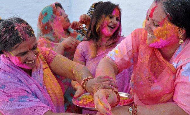 BJP mahila morcha workers celebrate Holi, the festival of colors in Bikaner on Saturday...