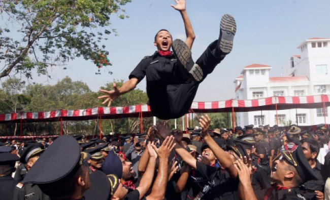 Cadets lift a colleague after a passing out parade at Officers Training Academy in Chennai...