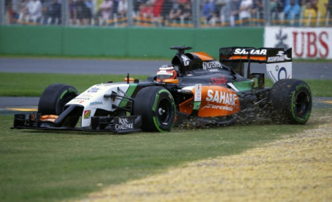 Force India Formula One driver Nico Hulkenberg of Germany drives to gravel during the qualifying...