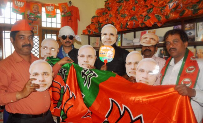 BJP workers wearing mask of party\'s Prime Ministerial candidate Narendra Modi, at a campaign...
