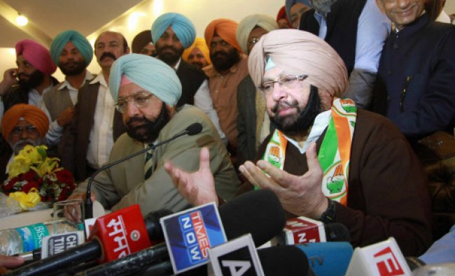 Former Punjab CM and Congress leader Capt Amarinder Singh (R) along with his brother...