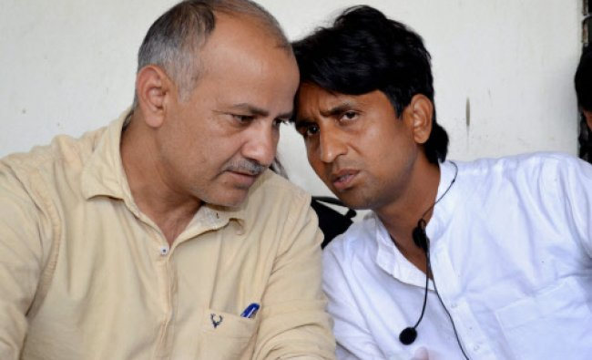 AAP candidate Kumar Vishwas with party leader Manish Sisodia during a press conference...