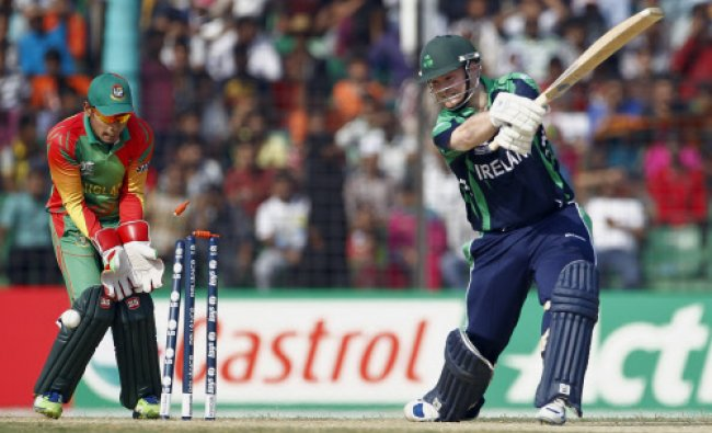Irelands Paul Stirling is bowled out by Bangladeshs Sohag Gazi during a warm up cricket match...