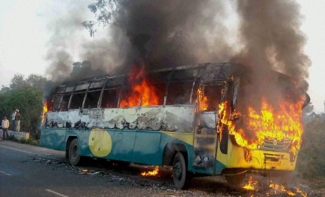 A passenger bus catches fire in Etawah on Saturday...